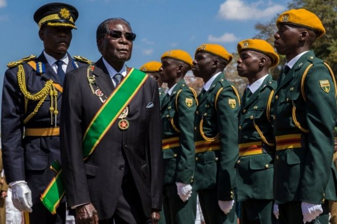 Zimbabwe's President Robert Mugabe inspects a guard of honour on 14 August, 2017.