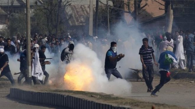 A teargas shell explodes in front of Kashmiris protesting outside Eidgah, a prayer ground, in Srinagar, Indian controlled Kashmir,