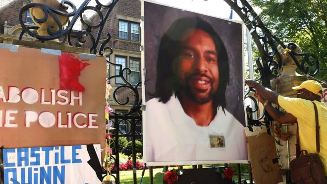 Protesters hang image of Philando Castile on gates of governor's residence in St Paul, Minnesota. 24 July 2016