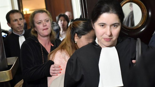 One of the alleged victims (2ndR) arrives to attend the trial of the UAE princesses at the Brussels criminal court for human trafficking on 11 May 2017