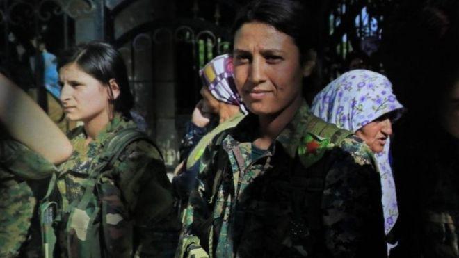 Kurdish female fighter Barin Kobani (right)