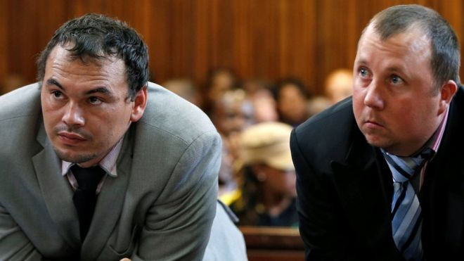 Farmers Willem Oosthuizen and Theo Martins (R) in court on 23 October 2017