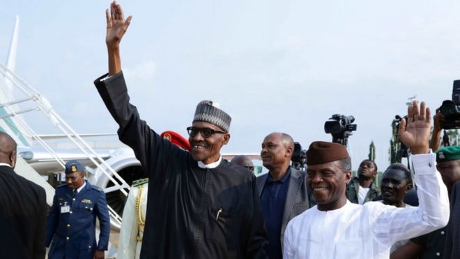 Mr Buhari waving at the airport