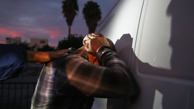 A man is detained by Immigration and Customs Enforcement (ICE), agents early on October 14, 2015 in Los Angeles, California.