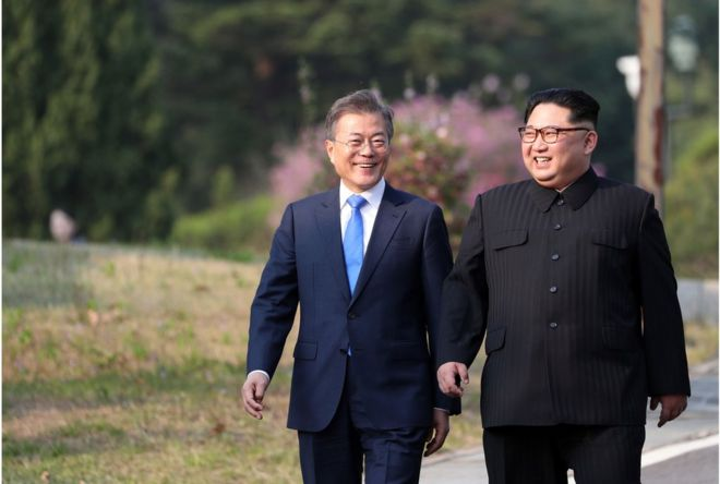 "North Korea""s leader Kim Jong Un (R) and South Korea""s President Moon Jae-in (L) walk together after a tree-planting ceremony at the truce village of Panmunjom on April 27, 2018. The leaders of the two Koreas held a landmark summit on April 27 after a highly symbolic handshake over the Military Demarcation Line that divides their countries, with the North""s Kim Jong Un declaring they were at the ""threshold of a new history"". / AFP PHOTO / Korea Summit Press Pool / Korea Summit Press PoolKOREA SUMMIT PRESS POOL/AFP/Getty Images"