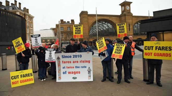 Campaigners protest against rail fare increases outside Kings Cross station in London
