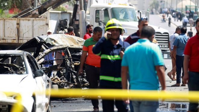 A wreckage of a car is seen at the site of car bomb attack near a government office in Karkh, Baghdad, Iraq (30 May 2017)