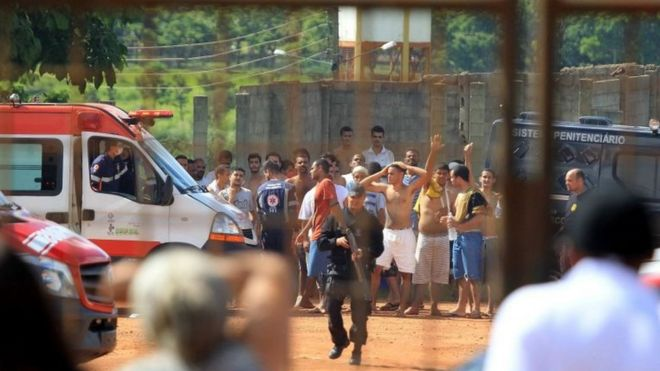 A handout photo made available by O Popular shows a group of inmates guarded by the authorities at a prison in the metropolitan region of Goiania, capital of the Brazilian state of Goias, Brazil, 01 January 2018.