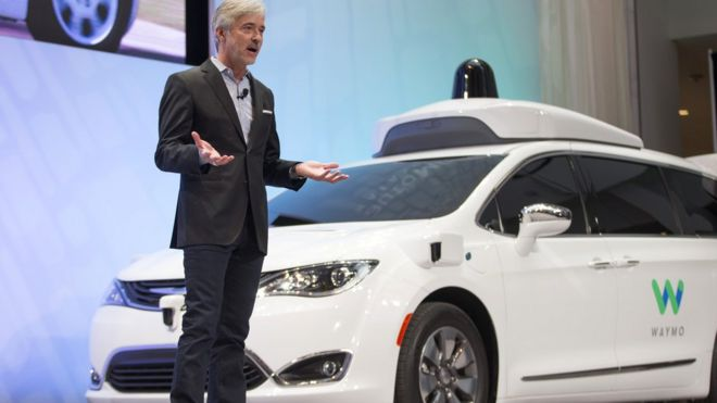 John Krafcik and a Waymo vehicle