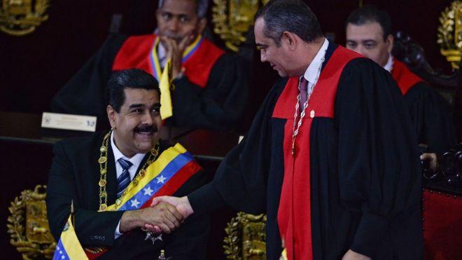 Nicolás Maduro y Maikel Moreno.