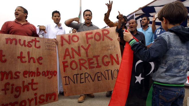 Libyans hold banners as they take part demonstration in the eastern coastal city of Benghazi calling for military forces to re-capture the southern city of Sirte from the Islamic State (IS) group without foreign intervention - 6 May 2016