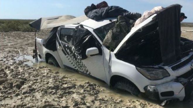 A picture of the vehicle submerged in mud