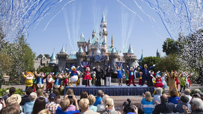 Characters and audience celebrate outside of Disneyland Park