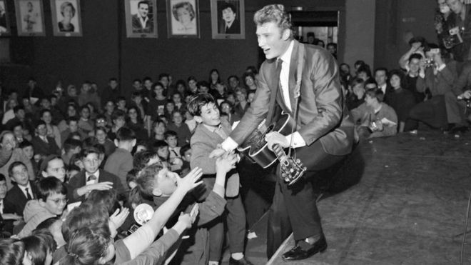 In this file photo taken on December 13, 1962 French singer Johnny Hallyday performs a concert at the Olympia hall in Paris.