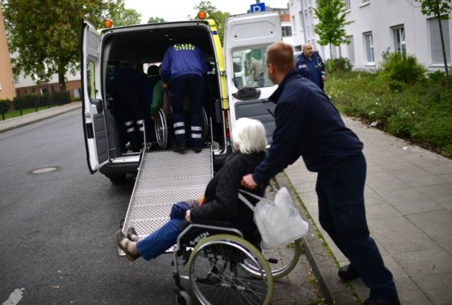 Elderly people from a senior care facility wait to board a bus as part of the evacuation of 50,000 people on 7 May, 2017 in Hannover, Germany.