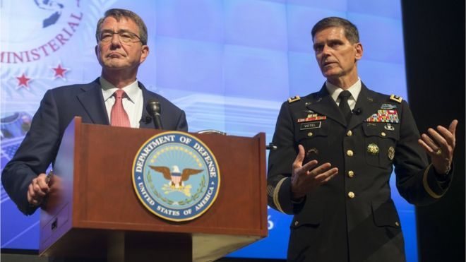 US Defence Secretary Aston Carter (L) alongside General Joseph Votel (