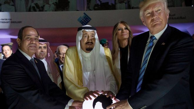 Egypt's Sisi, Saudi King Salman and Donald Trump pose with their hands on a globe