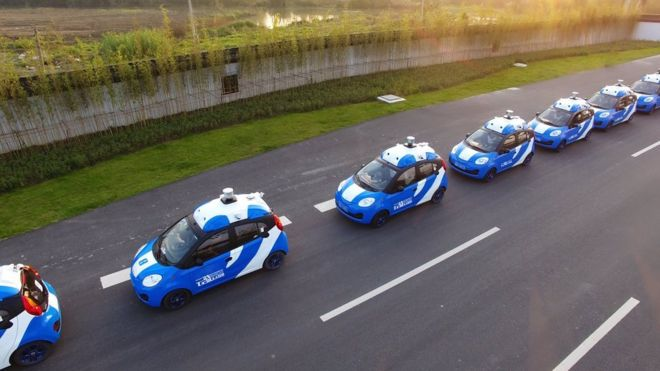 A row of Baidu driverless cars being tested on a track.