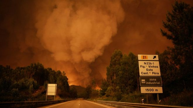 smoke rises abobe trees during a forest fire in Pedrogao Grande, Leiria District, Center of Portugal, 17 June 2017