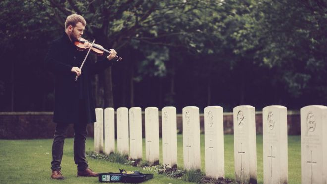 Sam Sweeney playing a violin at Ypres WWI cemetery