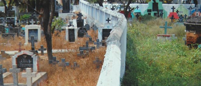 Wall built across the Catholic cemetery in Trichy, Tamil Nadu state