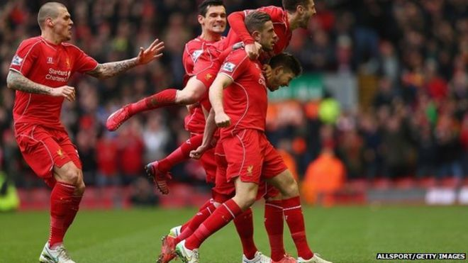 jordan henderson c of liverpool celebrates with teammates after scoring the opening goal during