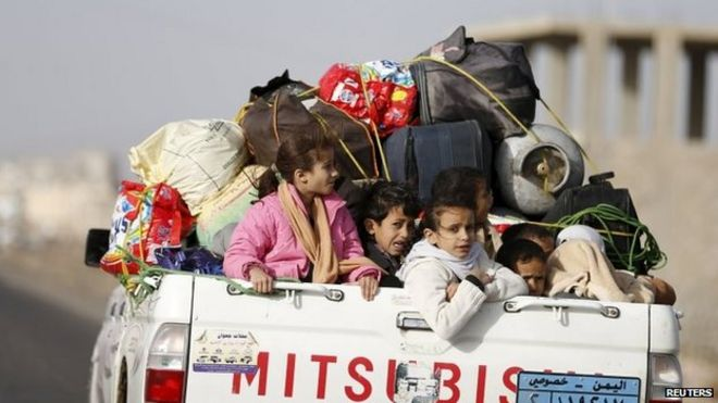 Yemen crisis. File photo: Children ride on the back of a pick-up truck with their