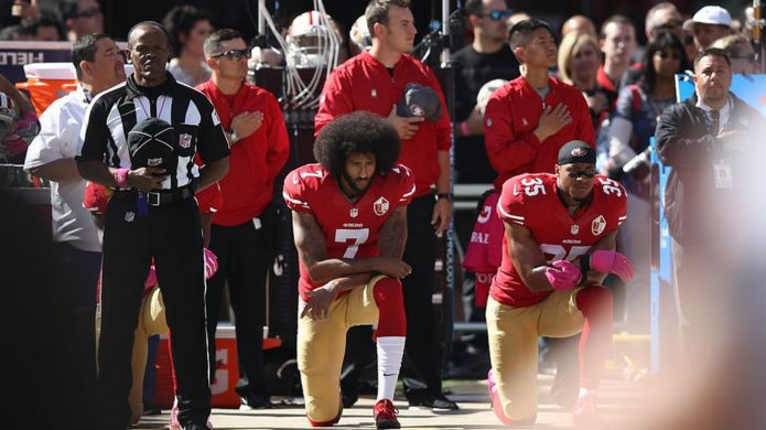 Eric Reid #35 and Colin Kaepernick #7 of the San Francisco 49ers kneel in protest during the national anthem prior to their NFL game against the Tampa Bay Buccaneers at Levi's Stadium on October 23, 2016