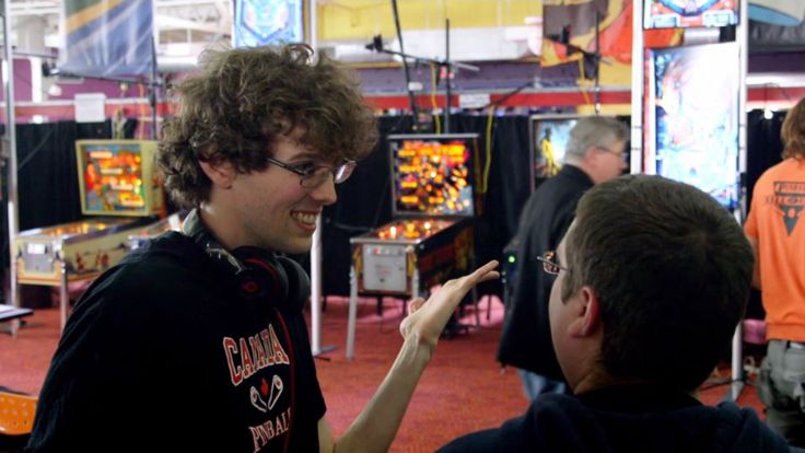 Robert Gagno talking to a fellow competitor at a tournament