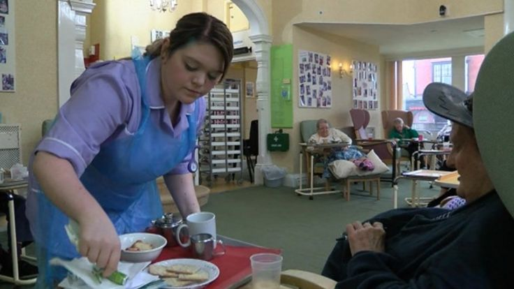 Adult social care worker providing care