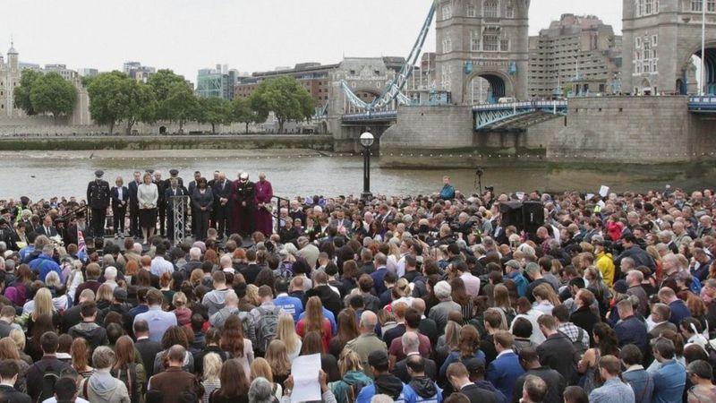 Crowds observe a minute's silence at vigil