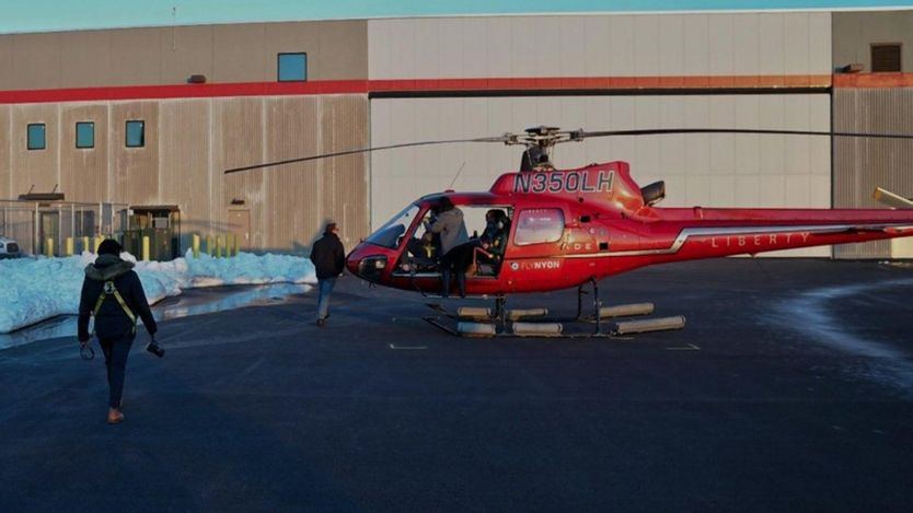 Photographer Eric Adams took a photo of the helicopter tour boarding their flight before the East River crash