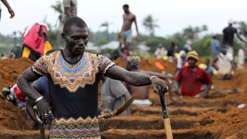 A worker is digging graves at the Paloko cemetery in Waterloo, Sierra Leone August 17, 2017. REUTERS