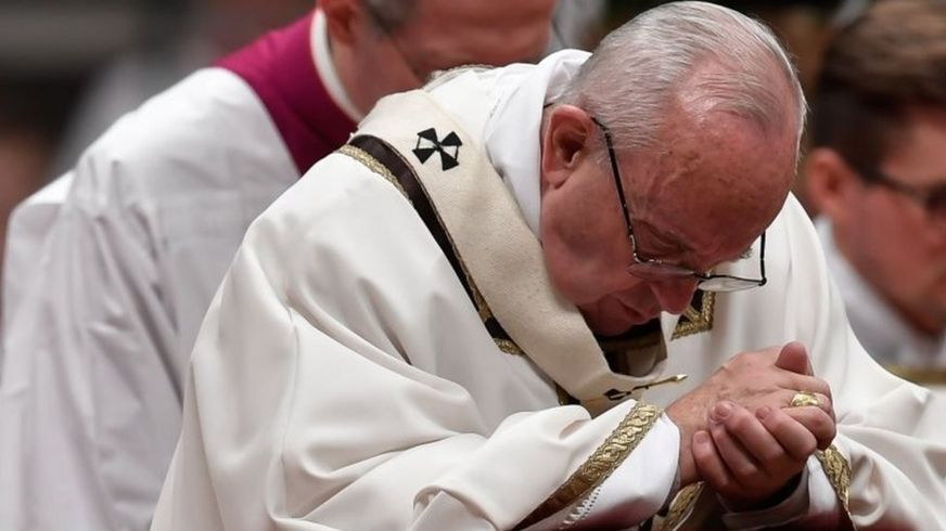 Pope Francis prays during a Christmas Eve Mass at St Peter's Basilica in the Vatican. Photo: 24 December 2017
