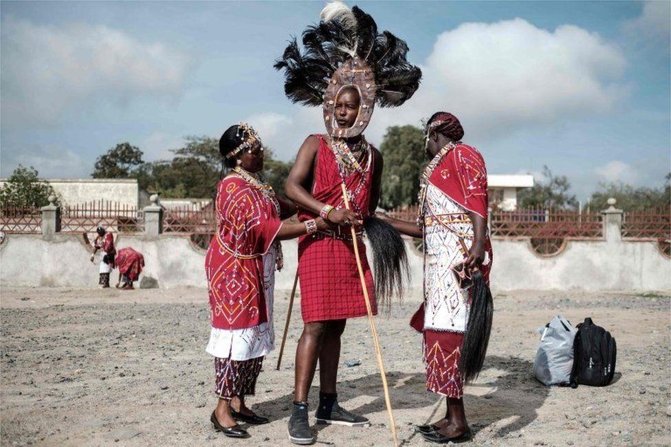 Staff of Kajiado county government prepare their Maasai tribe costumes for their cultural performance before Kajiado half Marathon calling for peace and cohesion in Kajiado, Kenya, on November 18, 2017.