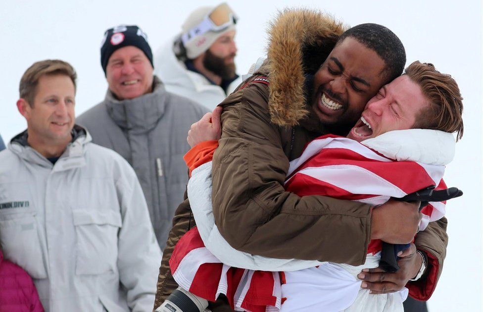 Shaun White hugs a friend in celebration