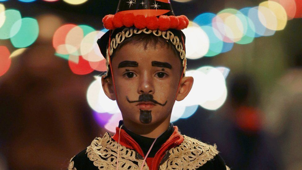 A boy wearing a folk costume takes part in a procession celebrating the religious holiday of Mawlid al-Nabi, the birthday of Prophet Mohammad, in Benghazi, Libya December 10, 2016