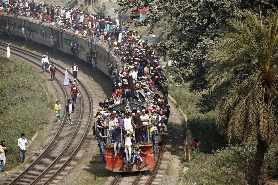 Bangladeshi Muslim devotees return home on an overcrowded train after attending the Akheri Munajat in Dhaka, Bangladesh, 21 January 2017.
