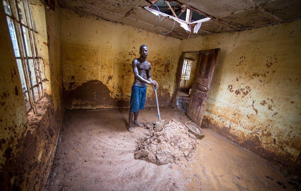 Abdul Mansaray claning his house