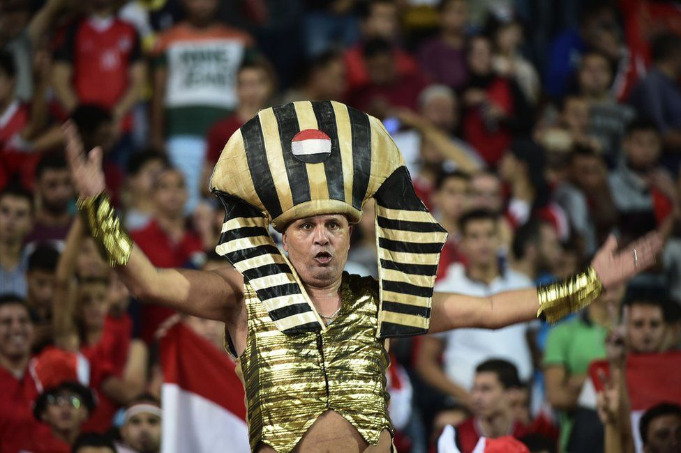 Egyptian fans cheer for their national team during the FIFA World Cup 2018 qualification football match between Egypt and Uganda at the Borg al-Arab Stadium near Alexandria on September 5, 2017.