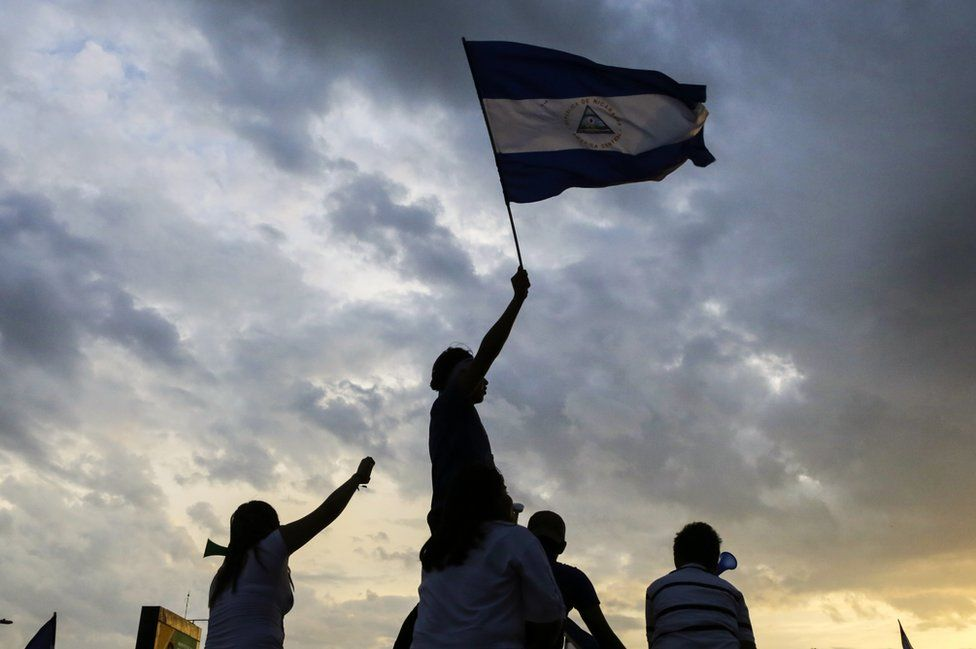 Students fly a Nicaraguan national flag as they take part in a protest against the government of Nicaraguan President Daniel Ortega in Managua on 15 May 2018.