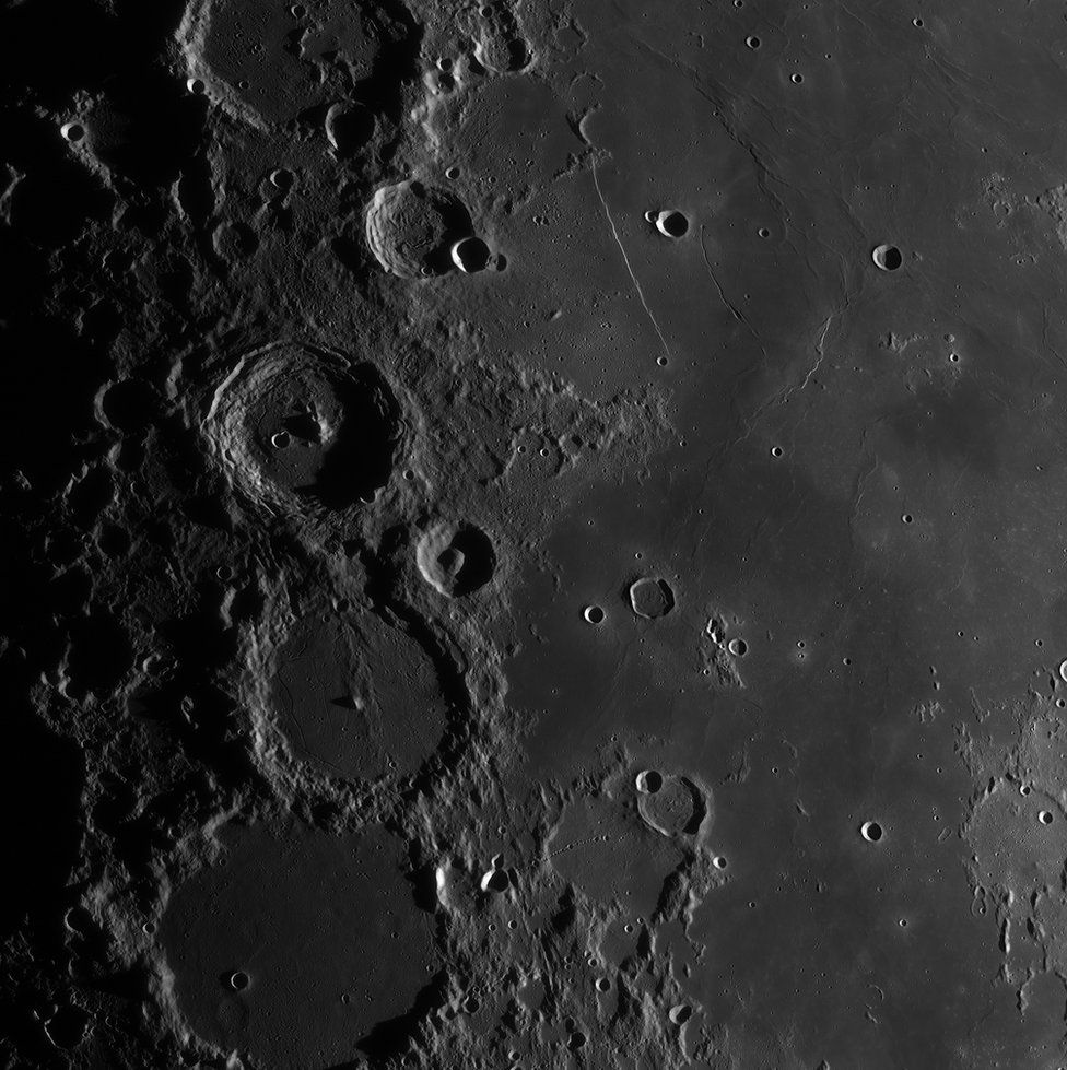 Craters on the surface of the moon.
