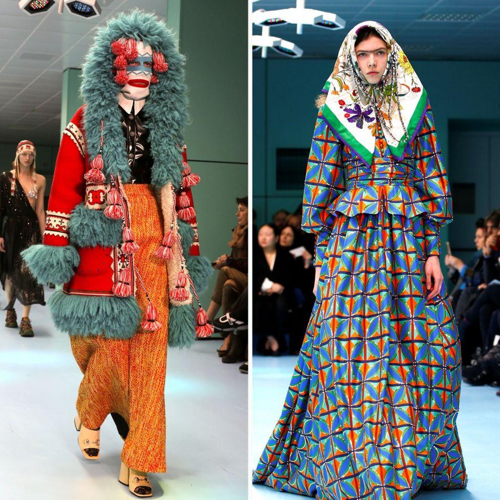 Dos modelos en la pasarela, uno con una falda de lana de colores brillantes, chaqueta y sombrero, y el otro con un vestido con estampado de brillantes colores y pañuelo en la cabeza