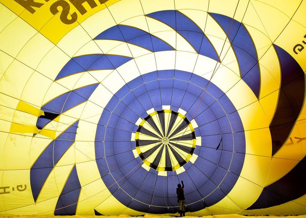 Linda Cossland-Clarke, Pilot of 3 Years Flying GHAZD, and a member of Women in Ballooning, checks the balloon fabric.