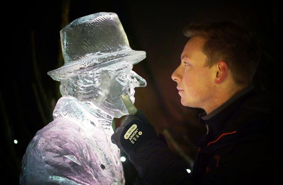 Master ice sculptor Jack Hackney puts the finishing touches to an ice sculpture.