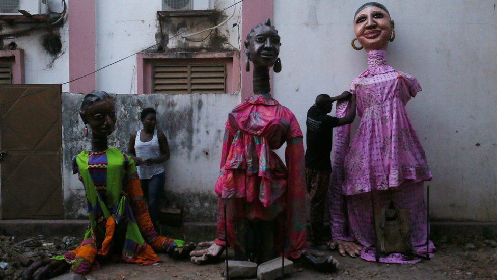 Dancers fix costumes after wearing them during a performance at the Musee du District in Bamako, Mali, December 9, 2016.