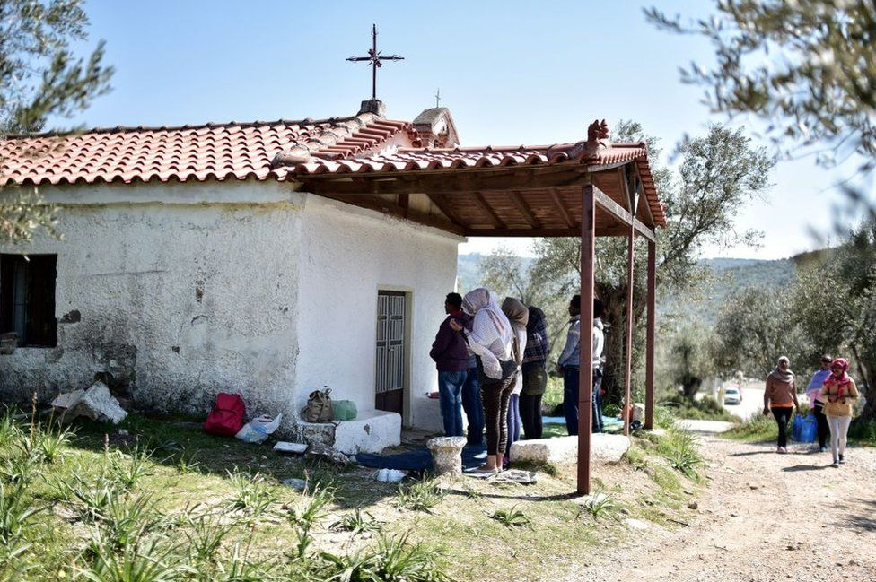 These Eritrean and Ethiopian Christians prayed outside a small Orthodox church on the Greek island of Lesbos on Tuesday, after making it over the Mediterranean.
