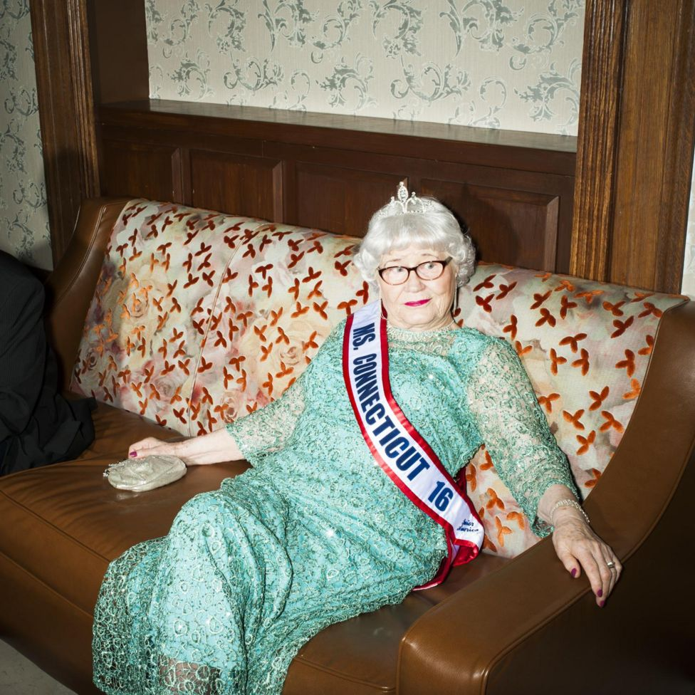 In a mint green dress, rhinestone earrings and tiara at the 2016 Ms Senior America pageant