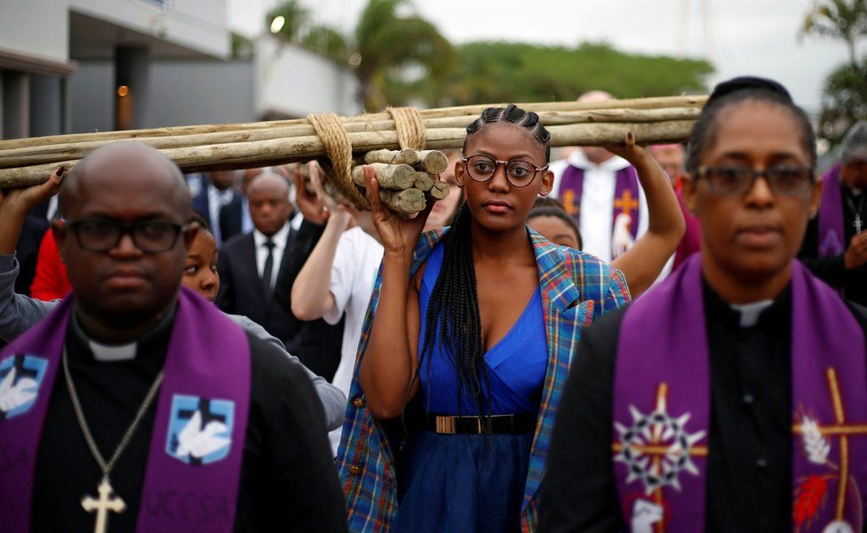 Christian faithful carrying a cross during a silent march in Durban, South Africa. April 14, 2017. REUTERS/Rogan Ward