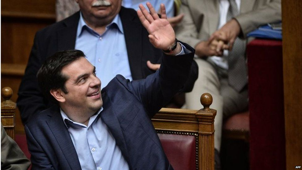 Greek prime minister Alexis Tsipras votes during a session at the Greek parliament in Athens early 23 July 2015